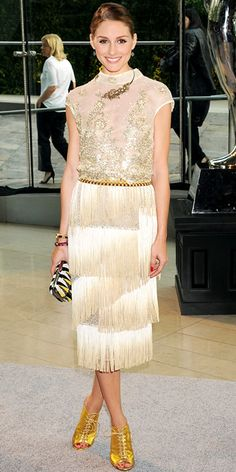 For the CFDA Awards, Olivia Palermo sparkled in a Dennis Basso's gold fringe dress, accented with jewelry, a beaded clutch, and lace-up heels.