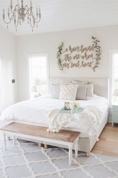 modern farmhouse master bedroom decor, farmhouse bedroom design rustic neutral bedroom design with white walls and white bedding nightstand decor, side table styling and wall art bench at end of bed Home Decor Bedroom, Bedroom Furniture, Furniture Design, Bedroom Ideas, Bedroom Designs, Diy Bedroom, Bedroom Wall Decorations, Modern Furniture, Bedroom Apartment