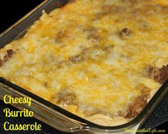 Cheesy Burrito Casserole Recipe Main Dishes with lean ground beef, onion, taco seasoning, flour tortillas, refried beans, Mexican cheese, condensed cream of mushroom soup, sour cream