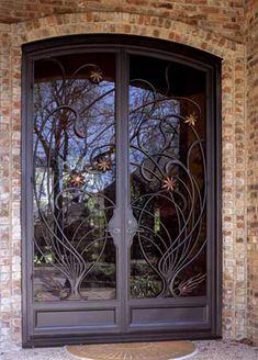 A Wrought Iron Art Nouveau Door With Copper Stars by Potter Art Metal Studios