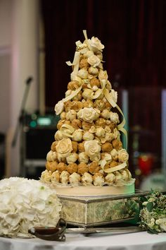 Handmade Italian inspired croquembouche with white chocolate and gold leaf. Captured by Paul Joseph Photography.