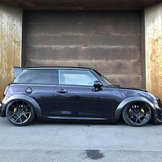 MINI WORKS custom built Mini Cooper with unique styling and performance modifications. Mini Works Special Edition cars built to order personalised styling, Black Mini Cooper, Mini Cooper Custom, Mini Coper, Carbon Fiber Spoiler, Roof Paint, Mini Cooper Clubman, Mini S, Running Gear, Performance Parts