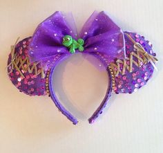 "Custom made ""Tangled"" Minnie ears  by Yeselyscreations on Etsy. It even has Pascal!"