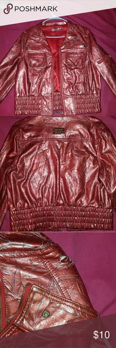 Apple bottom USED metallic Red jacket I had this jacket for years.its been used multiple of times but still in good  shape.it has a Tear on the Right shoulder Apple Bottoms Jackets & Coats