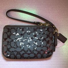NWT Coach Poppy Sequin Signature Wristlet Clutch Brand new and 100% authentic. Sequins design sparkles beautifully when the light hits it. Taken out of plastic for pictures only. All pictures of actual item.   🚫TRADES/HOLDS🚫 💰MAKE ME AN OFFER💰 🐣Please help me keep my closet friendly & drama free. If you're unhappy with my listing just purchase elsewhere🐣 💟Happy Poshing💟 Coach Bags Clutches & Wristlets