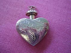Vintage Sterling Silver  Double Sided Engraved Heart Perfume Bottle Pendant. $55.00, via Etsy.