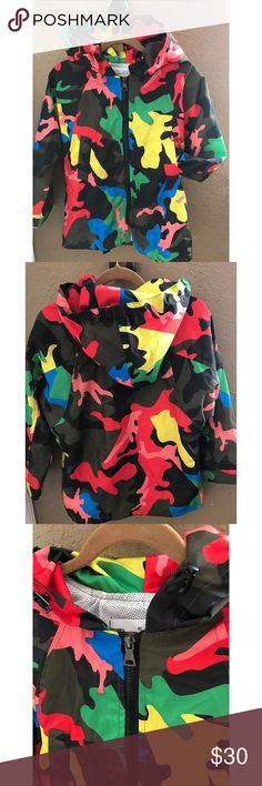 CAMO WInd breaker KID 5-7 Worn once. Like new=no flowers no rips no holder vibrant color perfect condition great for boy or girl to rock ...famous designer print. Well made. Jackets & Coats Raincoats