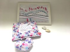 This gift set consisting of an original design baby taggie blanket and illustration is perfect for your favorite little one's playtime in her/his nursery. Baby taggie blanket is an original sSCAPESs design and unique in its fabric combination and colors. It has a triple function - it can be used as burp cloth, as squeeze & squeak toy and as a teether. The hanging heart has a squeeze & squeak function. The taggies stimulate motor and tactile skills. Fabric Combinations, Hanging Hearts, Baby Design, Burp Cloths, Little Ones, Embellishments, Nursery, Toy, Blanket