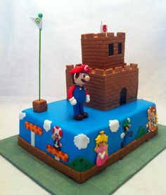 October 2012. Super Mario Cake with Mario, Luigi, Princess, Toad and Bowswer. Chocolate cake with cream cheese BC filling, buttercream and fondant. The castle is cake as well. Mario is gum paste. By Silver Cake Studio.