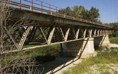 Muga Bridge, Rosas, Girona, Catalonia, Spain, Europe  Completed in: 1939 Structural Type: Simply-supported Warren deck truss bridge Materials:      Truss:  Steel      Deck slab:  Reinforced concrete  Span lengths: 3 x 30.50 m  Designer: Eduardo Torroja y Miret Engineer: G. Andreu)