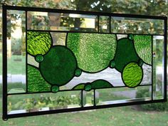 stained glass green monochromatic circles. I like the color scheme