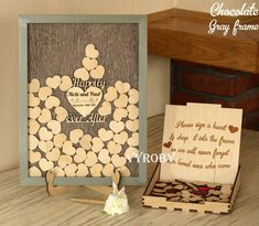 Welcome friends! This rustic wedding guest book alternative sign drop box in a gray frame with a wooden heart Happily Ever After. Brown guestbook with your names. The exclusive guestbook is handmade for you. The set includes a personalized frame and small hearts. The sign and stand for