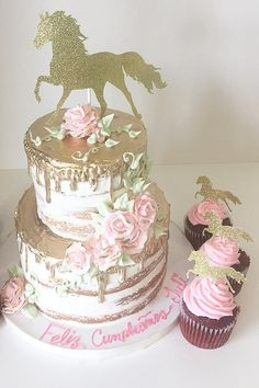 2 tier naked buttercream cake with gold drizzle and gold horse topper. Additional cupcakes to match.