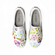 The bright, soft colors of this floral design against the all-white slip-on will have you thinking about warmer days even during the coldest of weather. <ul><li>Slip-on silhouette</li><li>High-quality artist-designed screenprint on canvas</li><li>100% cotton lining</li><li>Cushion & comfort bubbles</li><li>Removable in-sole</li><li>Machine wash cold; air dry</li></ul>