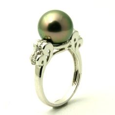 Cultured Tahitian Pearl & Diamond Engagement Ring - Here's a stunning Cultured Tahitian Pearl & Diamond Engagement Ring stamped in 18k White Gold featuring a Light Mystic Topaz colored Tahitian Pearl set on the top of the ring along with White accent stones on the top portion of the vintage style shank. This Tahitian Pearl ring is 10.9mm in diameter & the total gem weight is equal to .37 carats. #unusualengagementrings