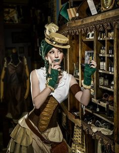 I love how the green gloves match the color of her hair and lipstick. And possibly the poison in the bottle... hmmmm maybe a steampunk poison ivy?