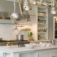 Deulonder - kitchens - charcoal, gray, walls, wainscoting, white, kitchen cabinets, kitchen island, light gray, quartz, countertops, subway tiles, backsplash, spice rack, open shelves, chalkboard, pot filler, island pot rack,