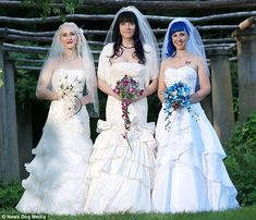 The 'married' lesbian threesome on their wedding day in August 2013...