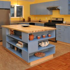 Our designer played with a balance between open shelving and closed cabinets throughout the kitchen, but the island really brings that theme to the forefront. The butcher block countertop is created of myrtlewood, and helps to soften and round out the palate.  #openshelving #kitcehncabinets #kitchenisland #butcherblock #myrtlewood #bluekitchen #contemporary #stainlesssteelsink #blackcountertop #shelving #boldcolors #blueandyellow #kitchen #remodel #interiors #interiordesign #kitchenremodel Construction Services, Butcher Block Countertops, Stainless Steel Sinks, Open Shelving, Bold Colors, Building Design, Kitchen Remodel, Cabinets, Interiors