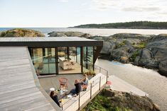 In the Norwegian town of Larvik in Vestfold County, Oslo-based practice Lund Hagem Architects renovated a summer cabin on a rocky terrain with generous outdoor patios that take advantage of dramatic coastal views. Lund, Norway House, Summer Cabins, Summer Houses, Timber Pergola, Modern Patio, Outdoor Photos, Deck Design, Landscape Design