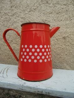 """Vintage French """"coffee pot in red enamel with white dots""""."""