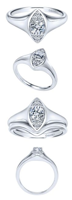 This white gold engagement ring comes with a round diamond locked in an elegant ellipse. The diamond comes included with this ring and it was gorgeously made by Gabriel & Co. This unique engagement ring has such a special look to it!