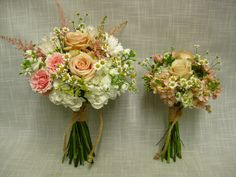 Simple, elegant, casual and slightly rustic handtied wedding bouquets in tones of white, cream, peach, pale pink and a hint of yellow. Bound with thick jute to keep with the casual feel.  Flowers include roses, stock, astilbe, fever few and spray roses .