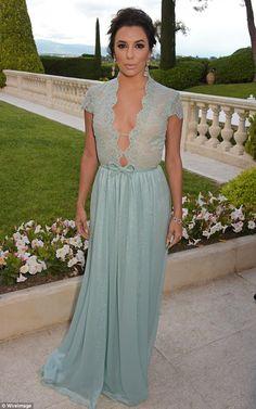 Feeling mint: Eva Longoria looked stunning in a low-cutGeorges Hobeika dress at the amfAR...