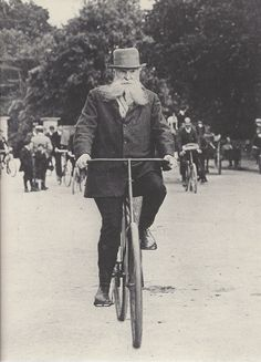 John Boyd Dunlop riding a bicycle complete with the pneumatic tyres which he invented. The first primitive bicycle had been developed in the 1790s and had gradually been improved throughout the 19th century. In 1888 Mr Dunlop created a set of inflated rubber tyres for his son's bicycle and patented the design which was widely adopted by cycling enthusiasts.