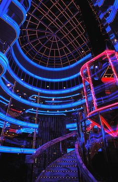 Red and blue neon atrium of Carnival Cruises Fun Ship by Carl Purcell.