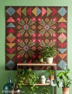 "Berry Blossoms.  Use a machine-appliqué technique that mimics the look of hand appliqué. Designer: Kim Diehl. Finished quilt: 60-1/2"" square. Finished block: 20"" square."