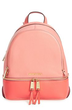 How cute is this colorblock backpack from Michael Kors? The pink hues and goldtone hardware make it a perfect pick for the season.