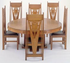 George Grant Elmslie (1869-1952) - Table and Side Chairs Set.  Oak, Laminated Wood, Leather. Circa 1910.