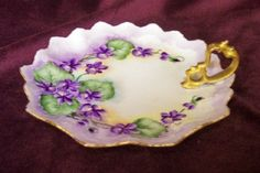 So pretty for your tea party!  Beautiful hand painted MZ Austria lemon dish with handle - painted with a lovely violet design and accented on the edge and handle with gold gilt. Marked in green on the bottom MZ Austria. $33.50