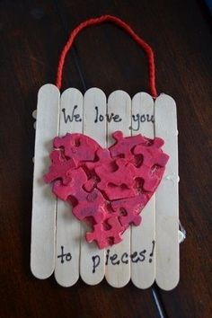 Valentine's Day craft for kids.  Made with puzzle pieces and craft sticks.  #valentine's day crafts. Get a free printable pop-up card you can make yourself at http://www.sewinlove.com.au/2016/02/05/free-valentines-day-card-funny/
