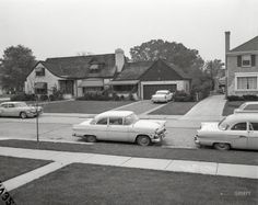 """Two-car families."" Columbus, Georgia, circa 1960. Three Fords, an Oldsmobile and a Pontiac. 4x5 acetate negative from the News Archive."