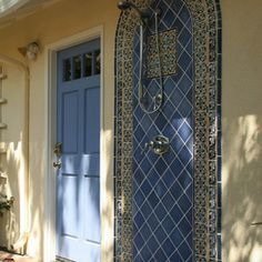 Striking and original exterior shower. Solid color tiles combined with traditional Mexican Talavera tiles. traditional exterior by Kathy Shaffer Architecture & Design AIA