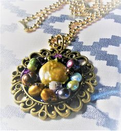 Fresh Water Pearls set in an Antique Pendant on a Brass Ball