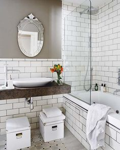 I like the white tile with grey grout  grey bathroom - white subway tile shower