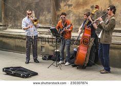 Street musicians in the center of Lviv, Lviv, Ukraine, May 10, 2014 - stock photo