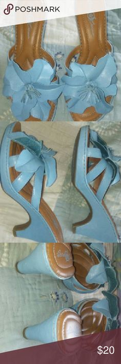 BORN CROWN BABY BLUE CLOGS OPEN TOE SO 6 I ABSOLUTELY LOVE THESE SLIP ON OPEN TOE CLOGS. THEY ARE BABY BLUE WITH A BIG TROPICAL LOOKING LEATHER FLOWER ON TOP, THE INSIDE ARE VERY CUSHION FOR COMFORT. THEY ARE A SZ 6. I WILL CONSIDER OFFERS SO PLEASE DON'T HESITATE TO ASK. born crown  Shoes Heels