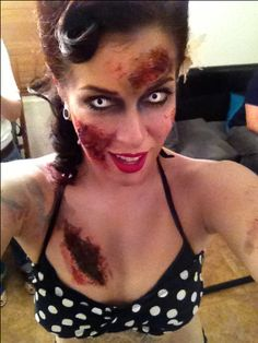 Myself as a zombie pin-up girl. The contact lenses made the look complete! Zombie makeup. Halloween. Halloween makeup. Pinup. Pinup girl. Retro. Zombie.
