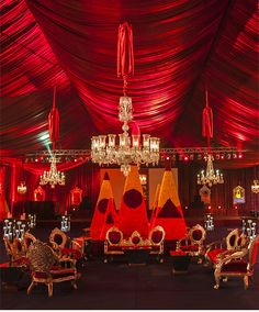 Rohit Bal Luxury Weddings & Events for bespoke corporate events, occasions, wedding design and production. Red Wedding Receptions, Wedding Reception Lighting, Wedding Entrance, Wedding Mandap, Entrance Decor, Indian Wedding Decorations, Wedding Events, Wedding Set Up, Wedding Stage
