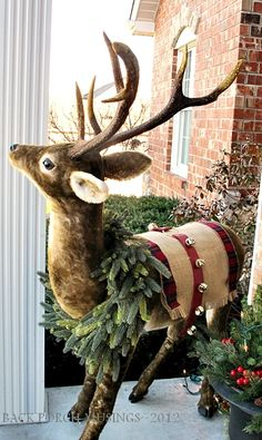 Christmas Front Porch - I used burlap for the front porch and yard light. Simple decorations for the entrance to G'ma and G'pa's house. The deer is very popular…