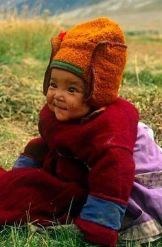 Faraway baby bundled up in native garb