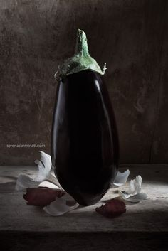 Aubergine with garlic and onion skin on wood. Part of my Personal Project, regularly published on foodfulife.com .