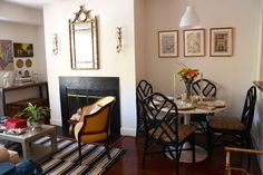 You could add a quaint table beside the fireplace for extra dining and for game playing and or reading.......