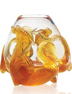 "Lalique Tianlong Vase   $45,000.00 	10 3/4"" 		  Item# 10015200  Limited Edition of 88 pieces!    Chimerical and fascinating creature from Asia, the dragon has often inspired artists. Named Tianlong, the celestial dragon is the most powerful of all. Lalique celebrates this legenday animal, symbol of strength, wealth and life, through the Tianlong amber vase, issued in a limited edition of 88 pieces, as homage to the figure 8 that brings good luck in the Chinese tradition..."