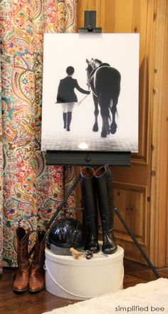 Equestrian teen bedroom decoration idea - easel horse and rider portrait, boots, and helmet
