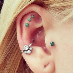 Tragus, Conch loop, and Triple flat of the ear cartilage piercing